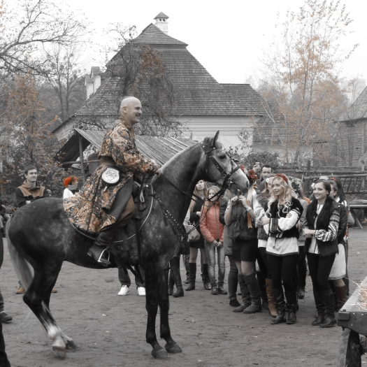 Cossack arrives by horse, and impresses the ladies