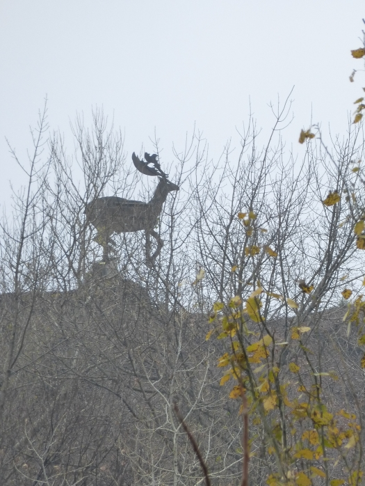 A deer made by one of the former employees stands watch over the site at the top of the slag heap that dominates the landscape