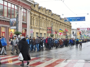 People march through Podil as part of the ongoing protests