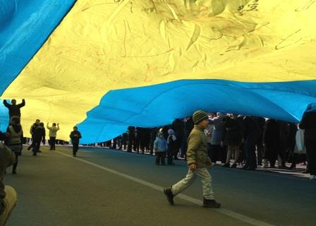 Children playing under giant silk flag at Maidan