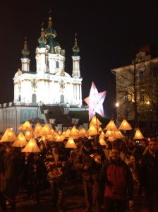 Procession passes the church on Andriivsky Uzviz